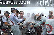 Ernesto Berterelli celebrates Alinghi's 5 - 0 win of the America's Cup by showering skipper Russel Coutts with Moet Champagne. 2/3/2003 (© Chris Cameron 2003)