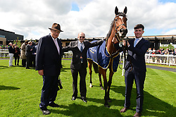 John Magnier and Michael Tabor with groom Padraig Palmer after Magical and Ryan Moore win the Group 1 Tattersalls Gold Cup during day two of the Curragh Spring Festival at Curragh Racecourse, County Kildare.