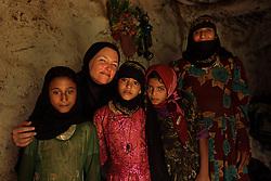 Photojournalist Stephanie Sinclair with eight-year-old brides Tehani and Ghada inside their mountain home in Hajjah, Yemen, Jan. 29, 2010.