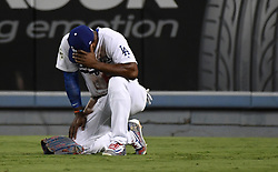 October 25, 2017 - Los Angeles, California, U.S. - Los Angeles Dodgers right fielder Yasiel Puig looks down after Houston Astros' Alex Bregman (not pictured) doubled in the eighth inning of game two of a World Series baseball game at Dodger Stadium on Wednesday, Oct. 25, 2017 in Los Angeles. Houston Astros won 7-6 in 11 innings. (Photo by Keith Birmingham, Pasadena Star-News/SCNG) (Credit Image: © San Gabriel Valley Tribune via ZUMA Wire)