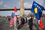 Kosovars with the new Kosovo and also the Albanian and the USA flag at the foot of the Brooklyn Bridge