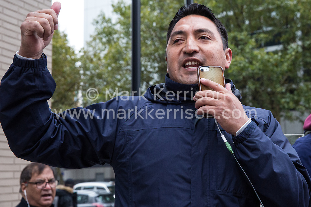 London, UK. 30th October, 2018. Henry Chango-Lopez, President of the Independent Workers of Great Britain (IWGB) trade union, addresses members and supporters of the Independent Workers of Great Britain (IWGB) trade union marching together with other precarious workers from the offices of Transport for London to the University of London via the Court of Appeal in support of Uber drivers who are seeking employment rights. The Court of Appeal will today hear an appeal by Uber against a ruling that its drivers are employees rather than self-employed workers.