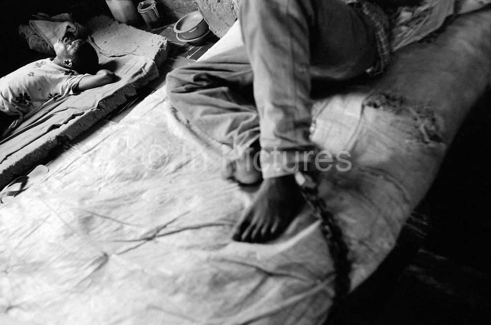 Inmate chained to the bed at Kissy Mental Hospital in Freetown, Sierra Leone
