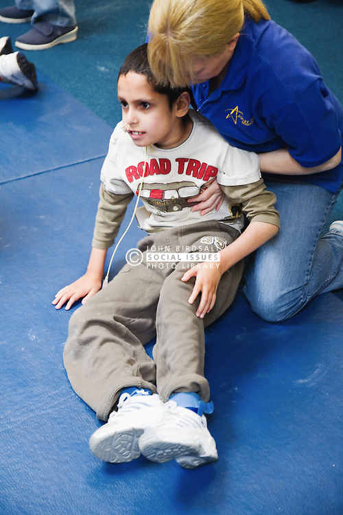 Therapeutic handling for pupil with physical disabilities,