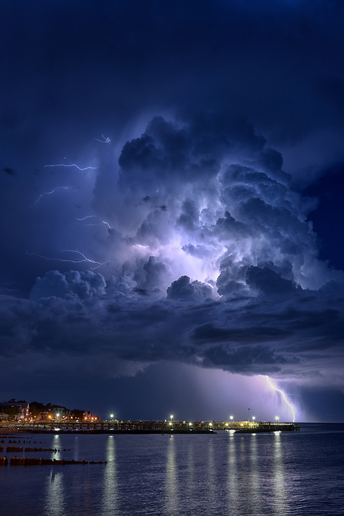 A bolt of lightning strikes the Chesapeake Bay during a brief and fast moving storm. As seen from North Beach in Calvert County, Maryland.