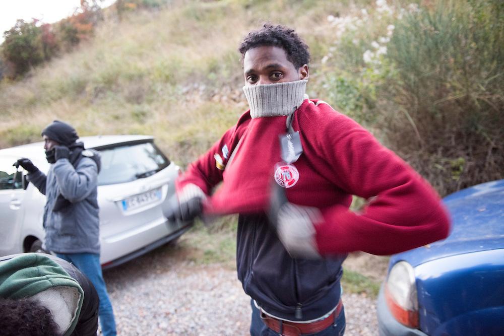 November 7, 2016 - Breil-sur-Roya, France: Eritrean migrants who just arrived by foot, in the cold mountains, receive clothes. 120 inhabitants of the village Breil-sur-Roya in the Roya valley, in the Alps on the French Italian border, formed a clandestine network to help migrants who walked into the valley from Ventimiglia, Italy.<br /> <br /> 7 novembre 2016 - Breil-sur-Roya, France: Les migrants érythréens qui sont arrivés à pied dans la montagne reçoivent des vêtements. 120 habitants du village de Breil-sur-Roya, dans la vallée de la Roya, dans les Alpes, à la frontière entre la France et l'Italie, ont formé un réseau pour venir en aide aux migrants.