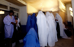BAHARAK HOSPITAL, 28 July 2005...In the corridor of Baharak-Hospital, mothers wait for their children to get vaccinated. ..The clinic provides vaccines against Tetanus, Polio, Thubercolosi, Measles and Diphtheria...Project supported by UNFPA..