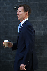 Health Secretary Jeremy Hunt arrives at Prime Minister David Cameron's final cabinet meeting following Theresa May's anticipated takeover as Leader of the Conservative Party and Prime Minister