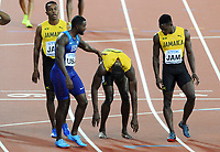Athletics - 2017 IAAF London World Athletics Championship - Day Thirteen, Evening Session<br /> <br /> Men's 4 x 400m Relay Final<br /> <br /> Usain Bolt of Jamaica is consoled by American sprinter Warren Gatlin in the home straight after a leg injury stopped him running at the London Stadium.<br /> <br /> COLORSPORT/ANDREW COWIE