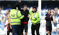 Football - 2017 / 2018 Premier League - Everton vs. Arsenal<br /> <br /> Jack Wiltshire of Arsenal gives his top to a pitch invader after the match at Goodison Park.<br /> <br /> COLORSPORT/LYNNE CAMERON