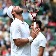 LONDON, ENGLAND - JULY 15:  Oliver Marach of Austria, in action, along with Mate Pavic of Croatian in the Men's Doubles Final on Center Court during the Wimbledon Lawn Tennis Championships at the All England Lawn Tennis and Croquet Club at Wimbledon on July 15, 2017 in London, England. (Photo by Tim Clayton/Corbis via Getty Images)