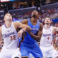 11 May 2014: Oklahoma City Thunder forward Serge Ibaka (9) vies for the rebound with Los Angeles Clippers forward Blake Griffin (32) during the Los Angeles Clippers 101-99 victory over the Oklahoma City Thunder, during Game Four of the Western Conference Semifinals of the NBA Playoffs, at the Staples Center, Los Angeles, California, USA.
