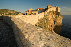 Europe, Croatia, Dalmatia, Dubrovnik.  View of historic houses and Adriatic Sea from old city walls (built 10th century).  The historic center of Dubrovnik is a UNESCO World Heritage site.