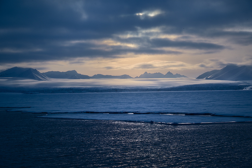 The least known place in Norway is Svalbard Archipelago. Actually, it belongs to Norway, but is situated far away in the Arctic ocean, close to the North Pole.<br /> This kind of landscape can be observed there in April-May, when the Sun doesn't set below the horizon and creates this magical light at 3 am.