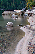 The rocky shoreline at Chilliwack Lake in Chilliwack Lake Provincial Park, Chilliwack, British Columbia, Canada