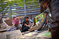 Artists make posters in Zuccotti Park during the  Occupy Wall Street Protest in New York...Photo by Robert Caplin.