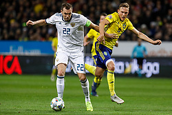 November 21, 2018 - Stockholm, Sweden - Ludwig Augustinsson (R) of Sweden and Artem Dzyuba of Russia vie for the ball during the UEFA Nations League B Group 2 match between Sweden and Russia on November 20, 2018 at Friends Arena in Stockholm, Sweden. (Credit Image: © Mike Kireev/NurPhoto via ZUMA Press)