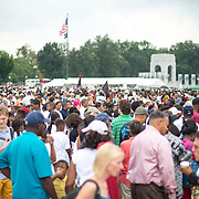 "Large crowds gathered despite the unsettled weather on Washington DC's National Mall at the commemoration of the 50th anniversary of the 1963 March on Washington famously remembered for civil right leader Martin Luther King Jr's ""I Have a Dream"" speech."