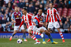 Stoke Forward Peter Odemwingie (NGA) is challenged by Aston Villa Forward Gabriel Agbonlahor (ENG) - Photo mandatory by-line: Rogan Thomson/JMP - 07966 386802 - 23/03/2014 - SPORT - FOOTBALL - Villa Park, Birmingham - Aston Villa v Stoke City - Barclays Premier League.