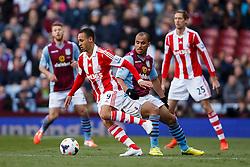 Stoke Forward Peter Odemwingie (NGA) is challenged by Aston Villa Forward Gabriel Agbonlahor (ENG) - Photo mandatory by-line: Rogan Thomson/JMP - 07966 386802 - 23/03/2014 - SPORT - FOOTBALL - Villa Park, Birmingham - Aston Villa v Stoke City - Barclays Premier League.