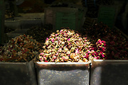 Dried rose buds on sale in a stall in a market