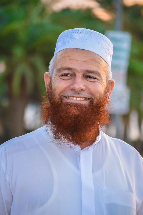 We met this guy in the streets of Aqaba Jordan & he invited me to a mosque, he also allowed me to photograph him. Alwys with a nice smile. One of the things that called my attention was his blue eyes and red beard.