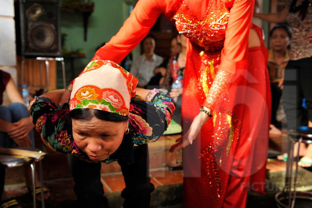 Spirits of ancestors take over audience bodies during Pha do gia Tien festival, Ta Tien Village, Hung Yen Province, Vietnam, Southeast Asia