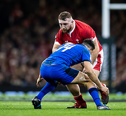 Wyn Jones of Wales under pressure from Leonardo Sarto of Italy<br /> <br /> Photographer Simon King/Replay Images<br /> <br /> Six Nations Round 1 - Wales v Italy - Saturday 1st February 2020 - Principality Stadium - Cardiff<br /> <br /> World Copyright © Replay Images . All rights reserved. info@replayimages.co.uk - http://replayimages.co.uk