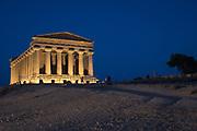 The Tempio della Concordia illuminated at twilight, Valley of Temples • Agrigento, Sicily, Italy
