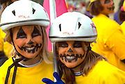 Friends age 14 with pumpkin faces at Anoka Halloween Festival Parade.  Anoka Minnesota USA