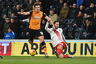 Harry Lennon of Charlton Athletic clears ball from Hull City defender Harry Maguire (12) during the Sky Bet Championship match between Hull City and Charlton Athletic at the KC Stadium, Kingston upon Hull, England on 16 January 2016. Photo by Ian Lyall.