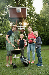 Young family garden barbecue kids tree-house