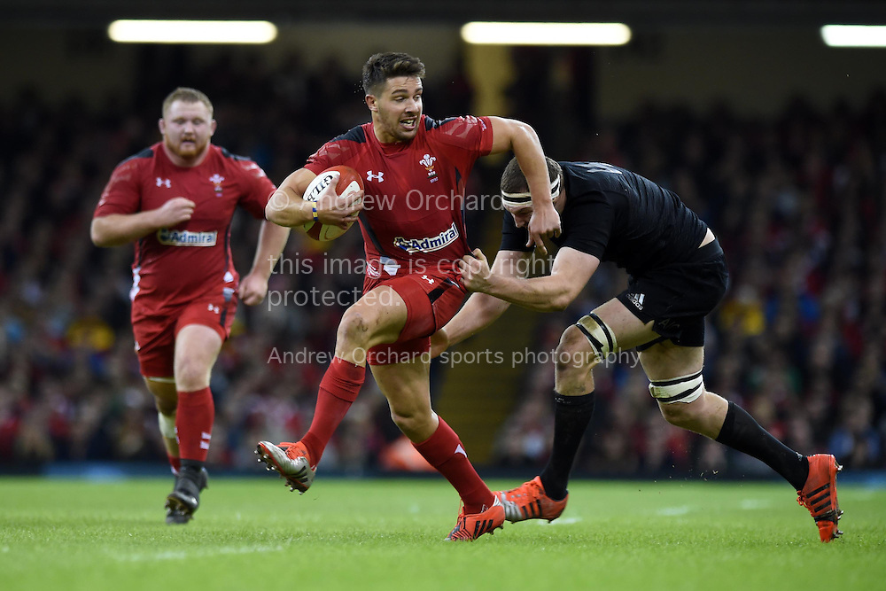 Rhys Webb of Wales breaks away from  NZ's Brodie Retallick. Dove Men Series 2014, Wales v New Zealand , autumn international rugby match at the Millennium Stadium in Cardiff, South Wales on Saturday 22nd November 2014<br /> pic by Andrew Orchard, Andrew Orchard sports photography.