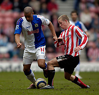 Photo: Jed Wee.<br />Sunderland v Blackburn Rovers. The Barclays Premiership. 25/03/2006.<br /><br />Sunderland's Grant Leadbitter (R) tries to tackle Blackburn's Steven Reid.