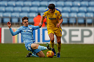 Coventry City midfielder Tom Bayliss (20) tackles Wimbledon defender Will Nightingale (5)  during the EFL Sky Bet League 1 match between Coventry City and AFC Wimbledon at the Ricoh Arena, Coventry, England on 12 January 2019.