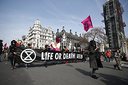 © Licensed to London News Pictures. 15/04/2019. London, UK. Extinction Rebellion protestors hold a mock funeral in Parliament Square as protests take hold throughout London and other UK cities to highlight global climate change. Photo credit: Peter Macdiarmid/LNP