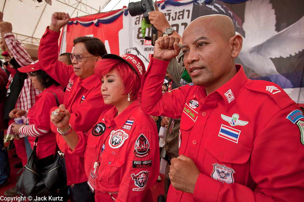 """Mar. 27, 2010 - BANGKOK, THAILAND:  Red Shirts on stage at the protest in Bangkok Saturday. More than 80,000 members of the United Front of Democracy Against Dictatorship (UDD), also known as the """"Red Shirts"""" and their supporters marched through central Bangkok March 27 during a series of protests against and demand the resignation of current Thai Prime Minister Abhisit Vejjajiva and his government. The protest is a continuation of protests the Red Shirts have been holding across Thailand. They support former Prime Minister Thaksin Shinawatra, who was deposed in a coup in 2006 and went into exile rather than go to prison after being convicted on corruption charges. Thaksin is still enormously popular in rural Thailand.    PHOTO BY JACK KURTZ"""