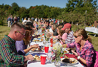 "Approximately 130 guests joined together at the table for Sunday morning's ""Breakfast in the Orchard"" at Smith Orchard in Belmont served by Chef Halligan and his crew from Local Eatery.    (Karen Bobotas/for the Laconia Daily Sun)"