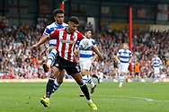 Brentford Forward Ollie Watkins (11) holds off QPR defender Darnell Furlong (2) during the EFL Sky Bet Championship match between Brentford and Queens Park Rangers at Griffin Park, London, England on 21 April 2018. Picture by Andy Walter.