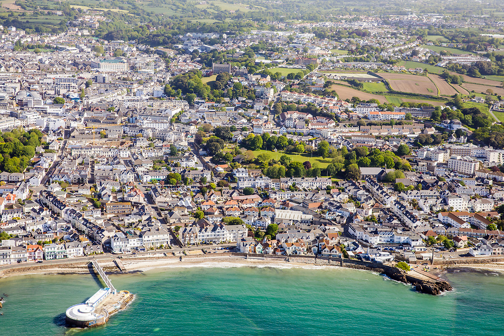 Aerial view of the beachfront residential properties at Harve des pas beach with St Helier town  beyond.