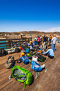 Visitors and gear on the pier at Bechers Bay, Santa Rosa Island, Channel Islands National Park, California USA