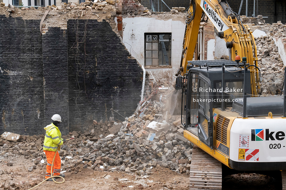 An excavator clears rubble and changes the urban landscape on the site of the former Elephant & Castle shopping centre which is being demolished and redeveloped in south London, on 22nd June 2021, in London, England. The much-criticised architecture of the Elephant & Castle Shopping Centre was opened in 1965, built on the bomb damaged site of the former Elephant & Castle Estate, originally constructed in 1898. The centre was home to restaurants, clothing retailers, fast food businesses and clubs where south Londoners socialised and met lifelong partners.