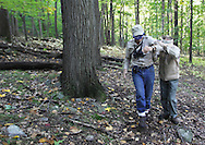 Salisbury Mills, New York - Naturalist Bob Kakerbeck of West Point's Natural Resources Branch leads the blindfolded George Muser of the Hudson Highlands Nature Museum away from a tree during an exercise about the senses on a hike with a group through Clove Brook Farm at the base of Schunnemunk Mountain on Oct. 2, 2010. The outing was organized by the Hudson Highlands Nature Museum.