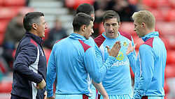 Burnley's Stephen Ward (second right) and team mates speak during warm up