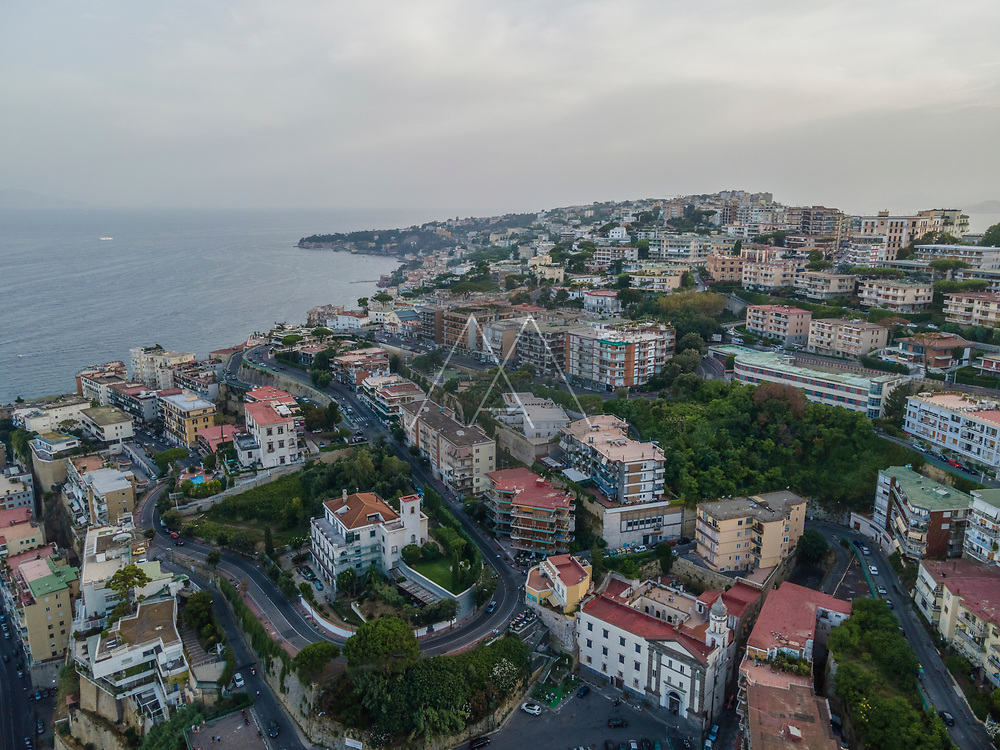 Aerial view of Posillipo on top of the hill during sunset, Naples, Campania, Italy.