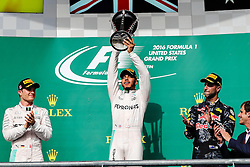 October 23, 2016 - Austin, Texas, U.S - Mercedes driver Lewis Hamilton (44) of Great Britain, Red Bull Racing driver Daniel Ricciardo (3) of Australia and Mercedes driver Nico Rosberg (6) of Germany stand on the podium after the US Grand Prix race at the Circuit of the Americas race track in Austin,Texas. (Credit Image: © Dan Wozniak via ZUMA Wire)