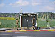Israeli Soldiers wait for a bus