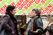 Femke Halsema is in gesprek met een van de leden van GroenLinks op de Mariaplaats in Utrecht. <br /> <br /> Party leader Femke Halsema of GroenLinks in discussion with people at the Mariaplaats in Utrecht during a campaign.
