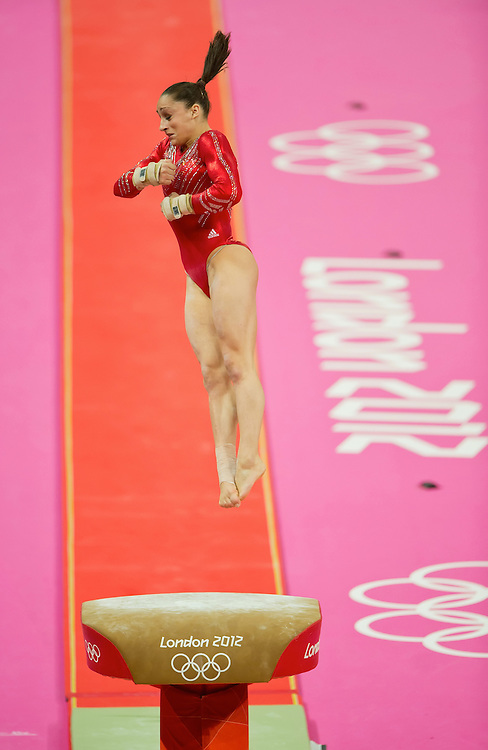 Jordyn Wieber of the United States lept off the vault apparatus apparatus during women's team gymnastics finals at North Greenwich Arena during the 2012 Summer Olympic Games in London, England, Tuesday, July 31, 2012. The United States won the gold medal in the event. (David Eulitt/Kansas City Star/MCT)