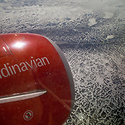 Three weeks aboard the Kong Harald. Hurtigruten, the Coastal Express. Flying above Norway with Scandinavian airlines SAS.